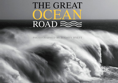 A coffee table book on the Great Ocean Road containing black and white photographs of the coastline as well as historical text and charts.